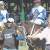 Jockeys riding hard